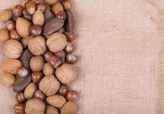Mixed nuts on hessian. Variety of mixed nuts on brown hessian Stock Photography