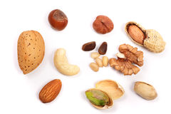 Mixed of nuts isolated on white background. Almonds, cashews, peanuts, hazelnuts, pine nuts, walnuts. Mixed of nuts isolated on white background. Almonds Royalty Free Stock Photography