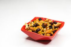 Mixed nuts in red bowl isolated royalty free stock image