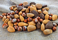 Mixed nuts on jute. Pile of mixed nuts on jute sack stock photography