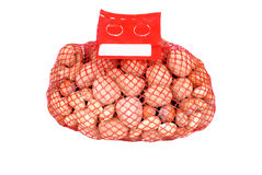Mixed nuts in a mesh bag Stock Photo