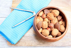 Mixed Nuts and nut cracker Stock Photo