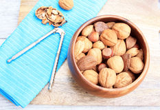 Mixed Nuts and nut cracker and walnut cracked Stock Photography