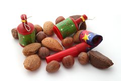 Mixed nuts with party blowers and poppers Royalty Free Stock Photos