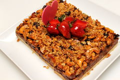Mixed nuts pie decorated with strawberry. Stock Photography