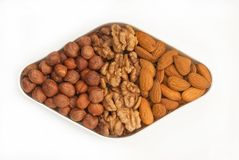 Mixed nuts on a plate Stock Images
