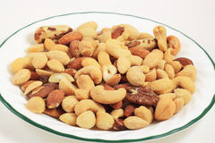 Mixed Nuts in Plate Stock Photos