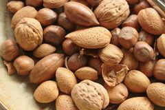 Mixed nuts on a plate close up stock photos
