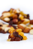 Mixed nuts and sultanas on a plate on a white background Royalty Free Stock Photos
