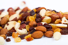 Mixed nuts and sultanas on a white background Royalty Free Stock Image