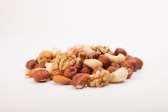 Mixed Nuts. On white background stock photos