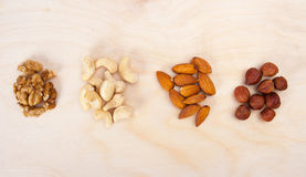 Mixed nuts. On wood background stock image