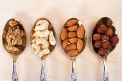 Mixed nuts. On wood background stock images