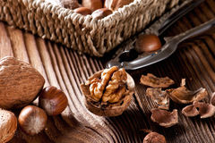 Mixed nuts on a wooden background. Natural background made from different kinds of nuts Royalty Free Stock Image