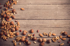 Mixed nuts on wooden background Royalty Free Stock Photo