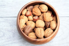 Mixed Nuts in wooden bowl Royalty Free Stock Images