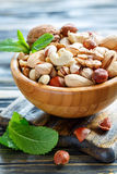 Mixed nuts in a wooden bowl. Royalty Free Stock Images