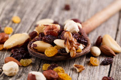 Mixed nuts on a wooden spoon. Royalty Free Stock Image