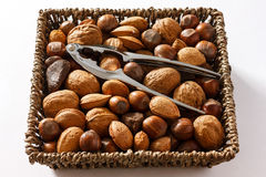 Mixed nuts in a woven basket Stock Photography