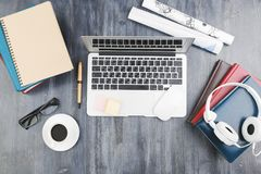 Wooden table top with office items and devices royalty free stock image