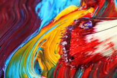 Mixed oil paint with paintbrush Royalty Free Stock Photography