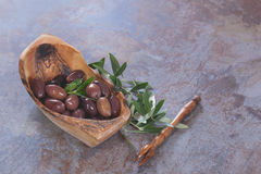 Mixed oily olives in olive wood bowl, close up Royalty Free Stock Photography