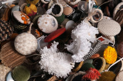 Mixed old used textile buttons. Close up of textile upholstery buttons mixed and not assorted Stock Photos