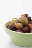 Mixed olives antipasto in dish Stock Photo