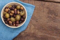 Mixed olives antipasto in dish Stock Photos