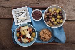 Mixed olives antipasto in dish Stock Images
