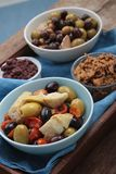 Mixed olives antipasto in dish Royalty Free Stock Images