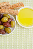 Mixed olives, olive oil and toasted bread. Royalty Free Stock Images