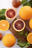 Mixed Oranges on Chopping Board Stock Photo