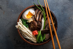 Mixed oriental mushroom stir fry with noodles soup and spring onion Royalty Free Stock Photos