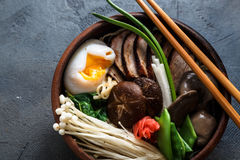 Mixed oriental mushroom stir fry with noodles soup and spring onion Royalty Free Stock Photo