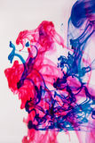 Mixed paint in water. Blue and purple color Royalty Free Stock Photography