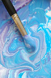 Mixed paints #1. Blue background stock photo