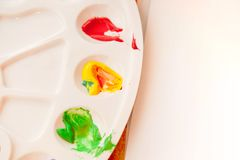 Mixed paints on a palette Stock Image