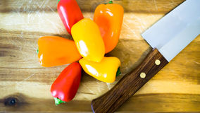 Mixed paprika and knife. On a cutting board Royalty Free Stock Photography
