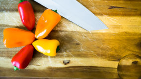 Mixed paprika and knife. On a cutting board Stock Images