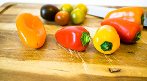 Mixed paprika and tomatoes. On a cutting board Royalty Free Stock Images