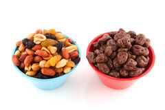 Mixed peanuts and chocolate raisins Royalty Free Stock Photography
