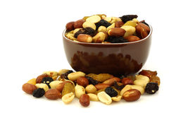 Mixed peanuts and raisins in a brown bowl Royalty Free Stock Photo