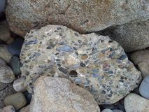 Mixed Pebbles in Concrete Stock Image
