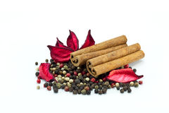 Mixed pepper and cinnamon sticks. Closeup of mixed pepper and cinnamon sticks Royalty Free Stock Images