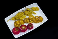 Mixed pepper pickles on the Top view. Mixed pepper pickles on the white plate at Top view Stock Photography