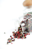 Mixed pepper seeds of various colours red black green Royalty Free Stock Photos
