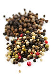 Mixed peppercorns. Mixed assorted peppercorns on white background macro stock image