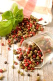 Mixed peppercorns with basil for cook Royalty Free Stock Photo