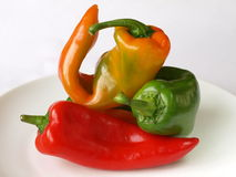 Mixed peppers. Composition of peppers on a plate stock photos